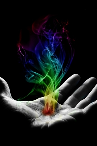 Colored Smoke in Hand Wallpaper