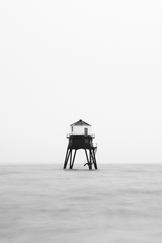 Foggy Lighthouse Wallpaper